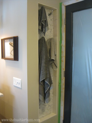 {towel nook, behind the door.  the top row MAY be almost too high for me to reach, but I make it on tiptoes.  I'm tall... not.}