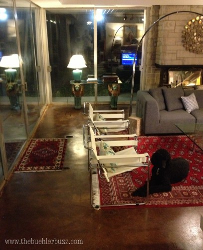{love love love love those Wassily (ahem, knockoff, ahem) chairs and the red rug against these floors}